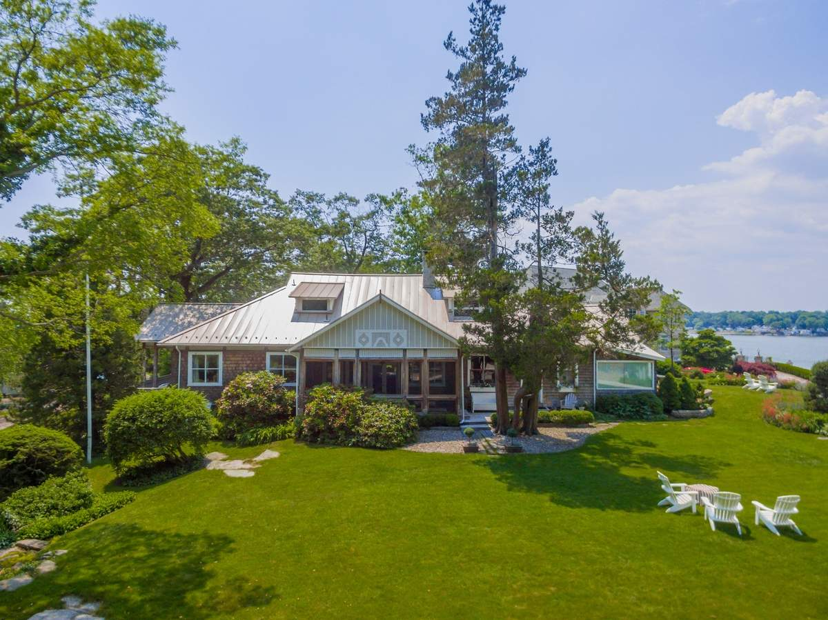 Water views abound at this historic Branford home.