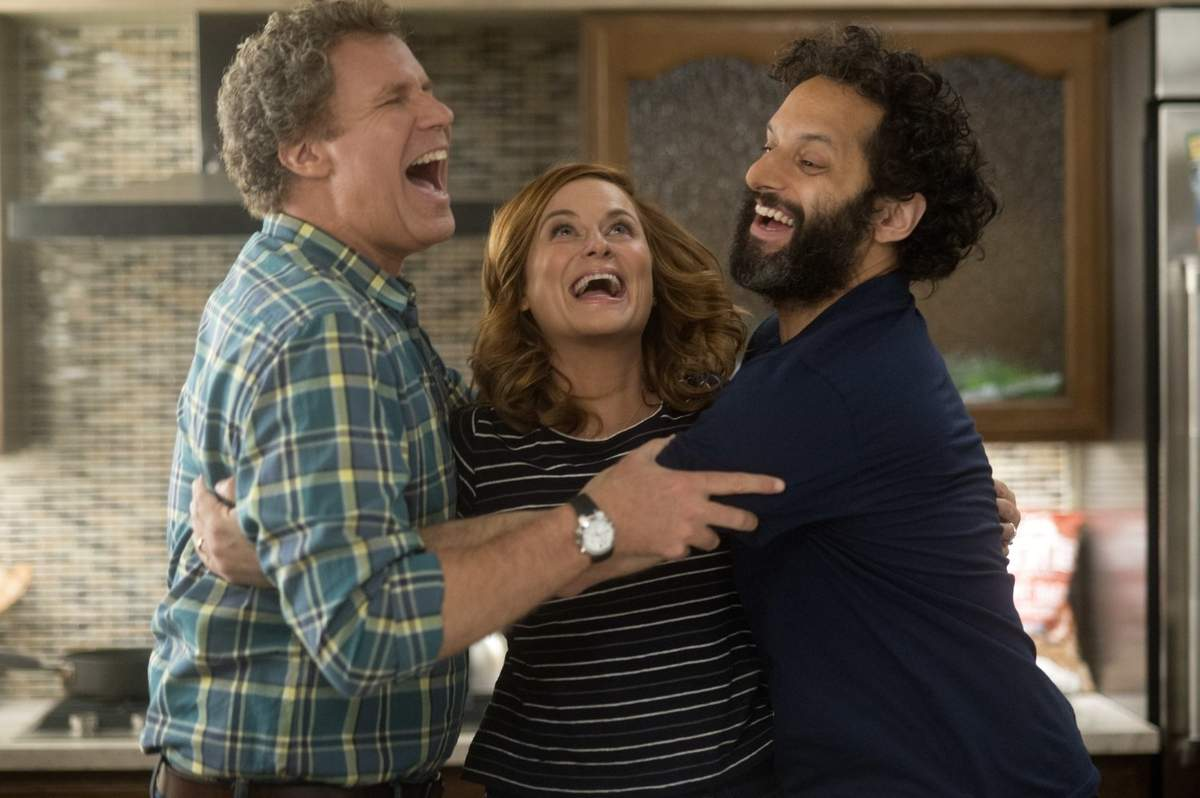 Scott (Will Ferrell), Kate (Amy Poehler), and Frank (Jason Mantzoukas) rejoice at the success of their money-making casino in the comedy, The House. Photograph by Glen Wilson. Copyright Warner Bros. Entertainment Inc. and RatPac-Dune Entertainment