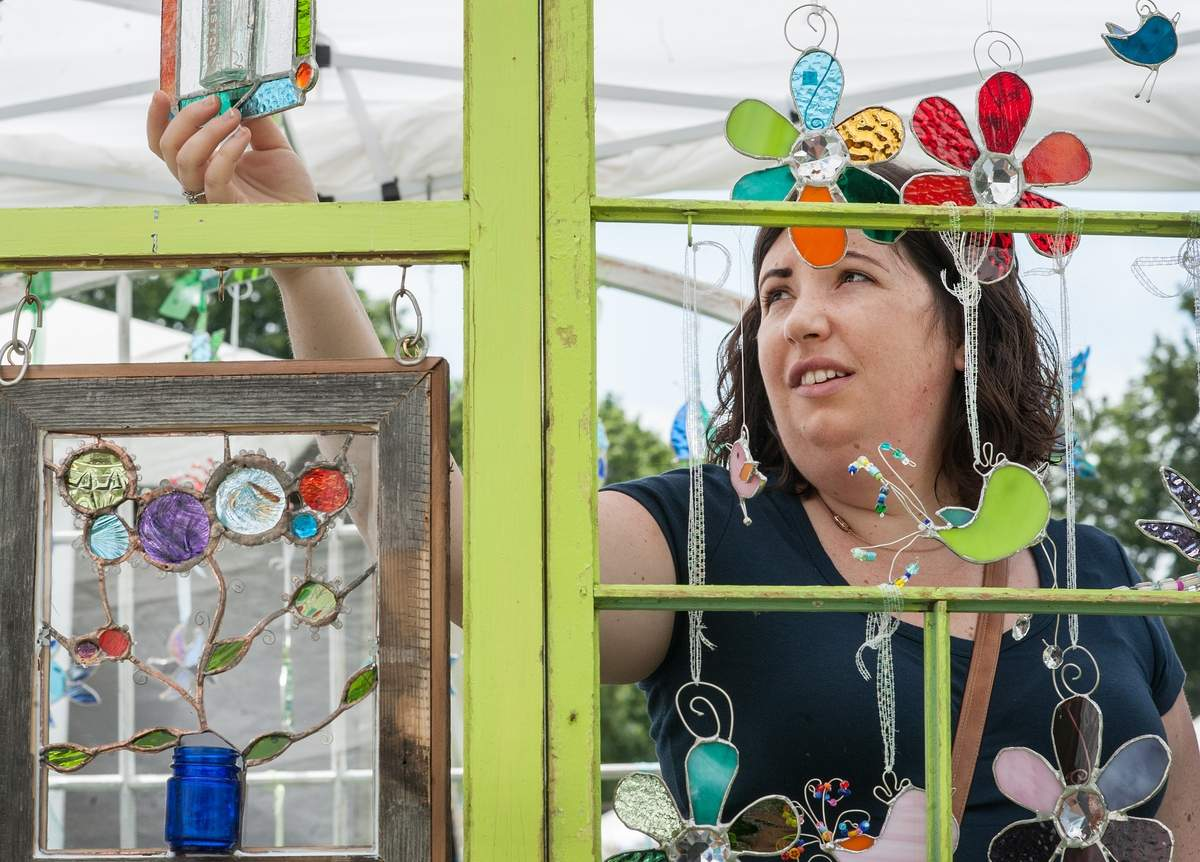 The Guilford Art Center held its Annual Craft Expon this  weekend on the Guilfrod Green.   A customer looks through the
