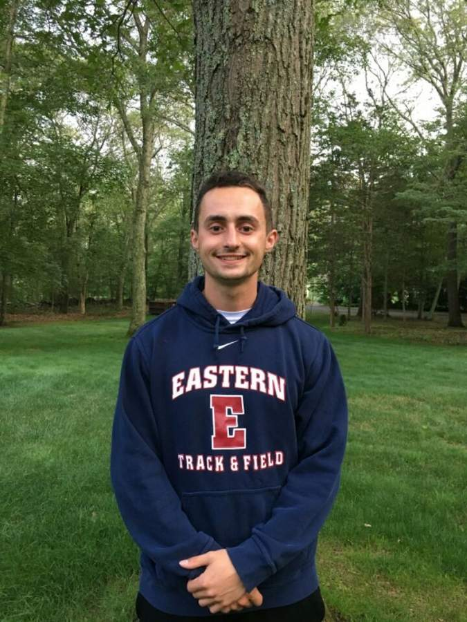 After joining the Haddam-Killingworth track and field program as a senior, 2014 graduate Nick Afragola stuck with the sport and earned All-New England honors in the 200-meter dash for the men's outdoor team at Eastern Connecticut State University this spring. Photo courtesy of Nick Afragola