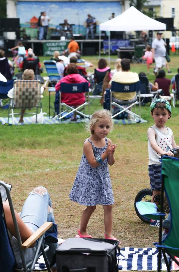 Summer concert on the Guilford Green. Jordyn dances to the music for her family.