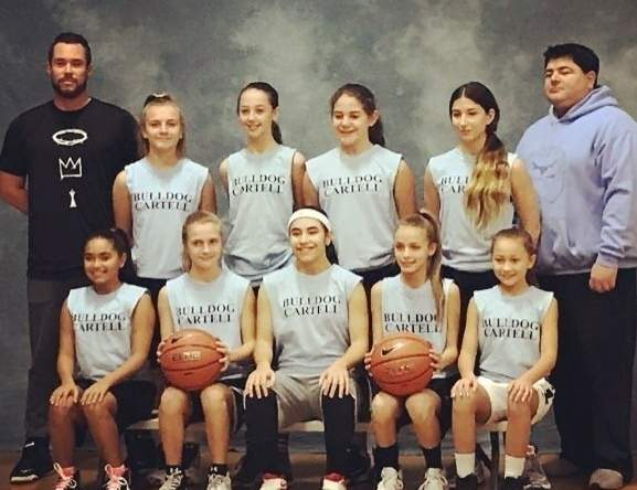 Pictured from the Bulldog Cartel Auto girls' basketball team are (back row) assistant coach Patrick Moore, Kate Pycela, Cash Carocci, Teresa Vitello, Mercedes Cestaro, and Head Coach Pasquale Cestaro; along with (front row) Jemelis Mateo, Emily Pycela, Olivia Vega, Madeline Diaz, and Adrianna Gonzalez. Photo courtesy of Julie Cestaro
