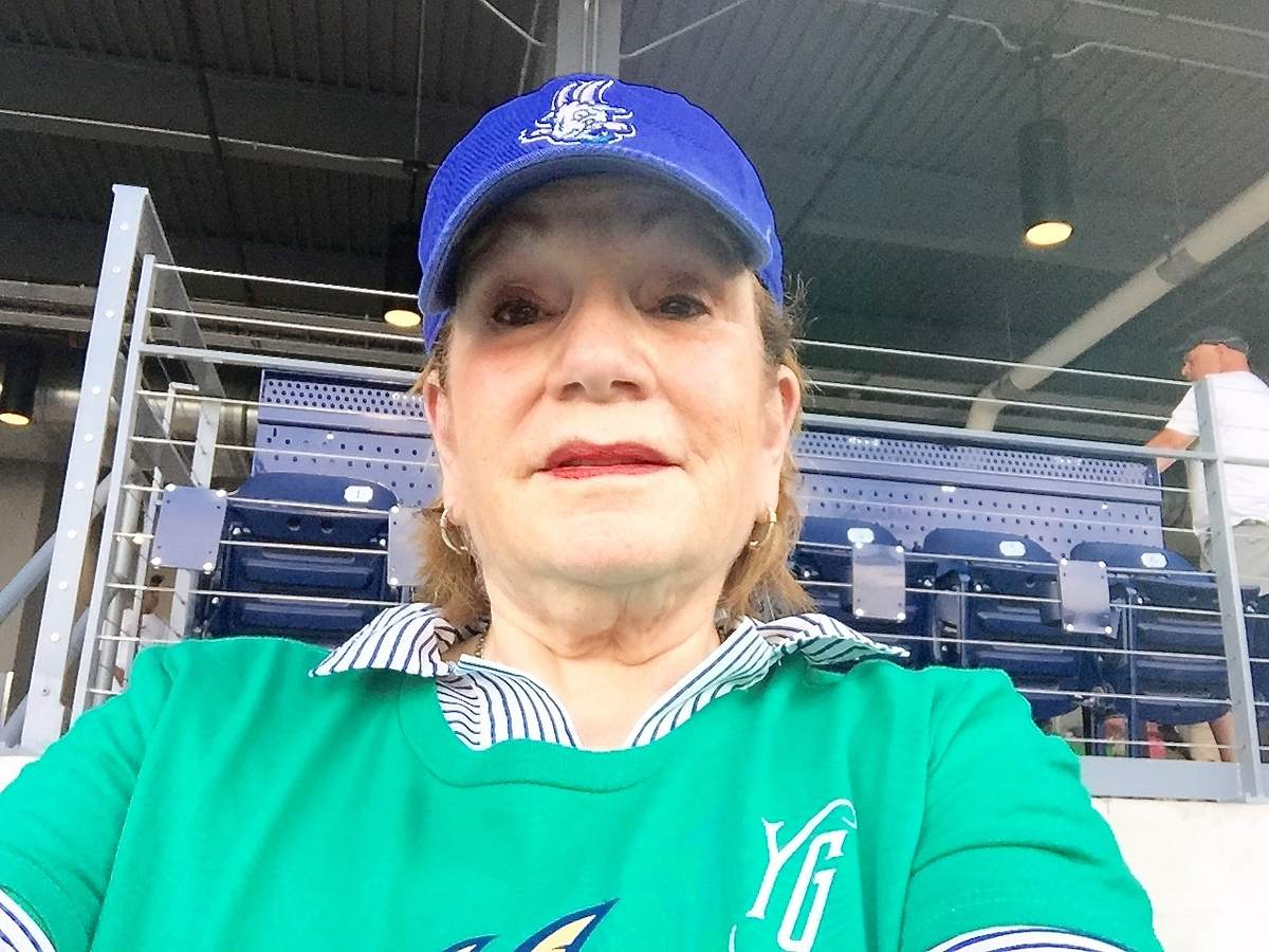 The author, lifelong baseball fan Rita Christopher, takes in her first Hartford Yard Goats game. Photo by Rita Christopher/The Source