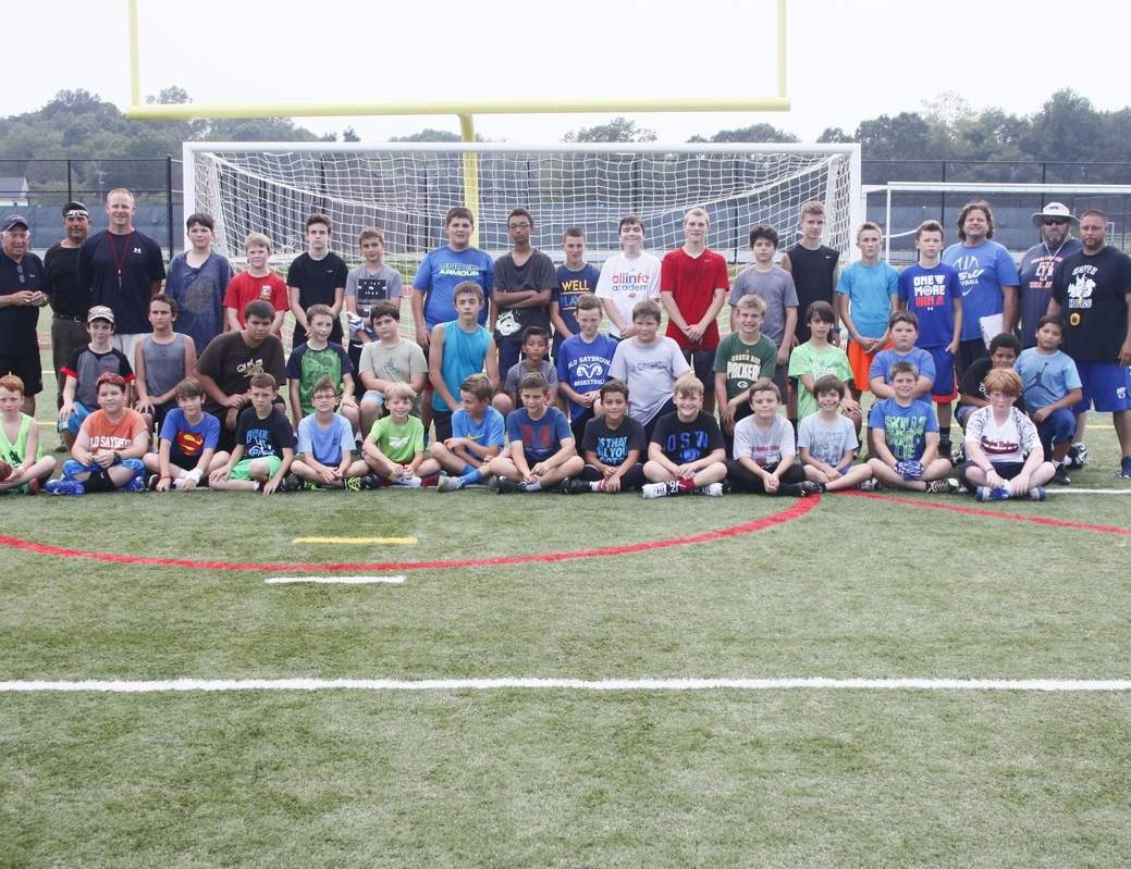 The Old Saybrook-Westbrook (OS-W) football squad teamed up with OS-W Youth Football and Cheer, as well as Old Saybrook Parks and Rec, for a four-day football program that saw local youngsters have fun, while learning the fundamentals of the sport. Photo courtesy of Susan Carpenter