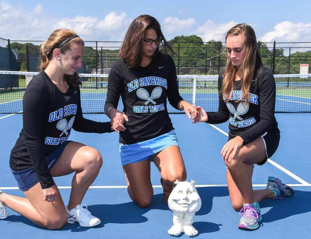 The members of the Old Saybrook girls' tennis squad gained strength from bringing their friend Bruth to their matches this spring. Pictured with Bruth are athletes Samantha Fucci, Rosie Rothman, and Erin Stangel. Photo by Kelley Fryer/The Courier
