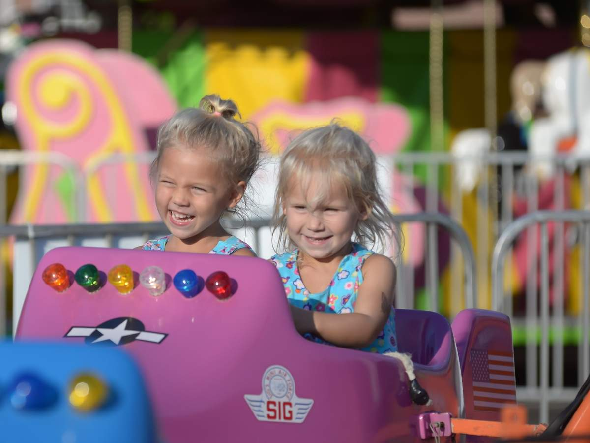 Saint George Carnival took place Wednesday - Saturday with rides, games, foods, the famous Cake Booth, raffle, and the giant White Elephant tag sale. Riley and Harper Maher take a ride in the pink airplane.