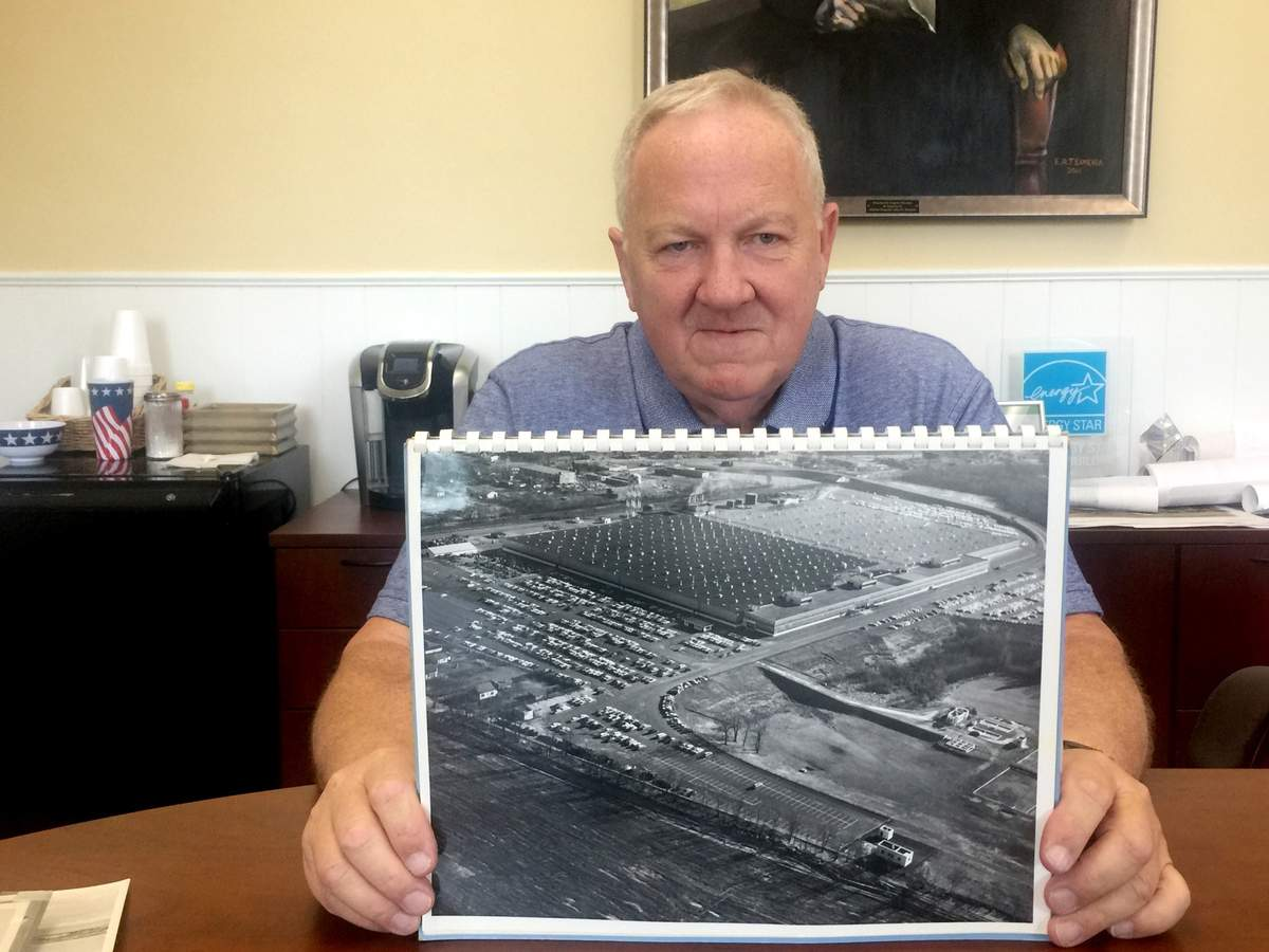 A former Pratt & Whitney worker, Bill Richards had acquired several aerial photos of the former Pratt & Whitney plant. He's donating the collection to the North Haven Historical Society, though copies will soon be framed in Town Hall. Photo by Matthew DaCorte/The Courier