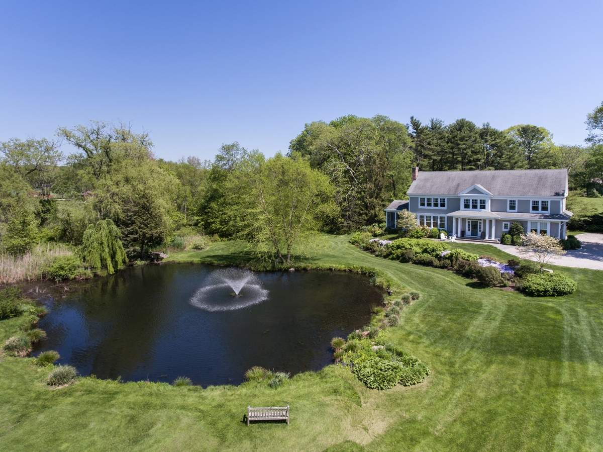 The home sits on 3.7 acres and overlooks a private pond.