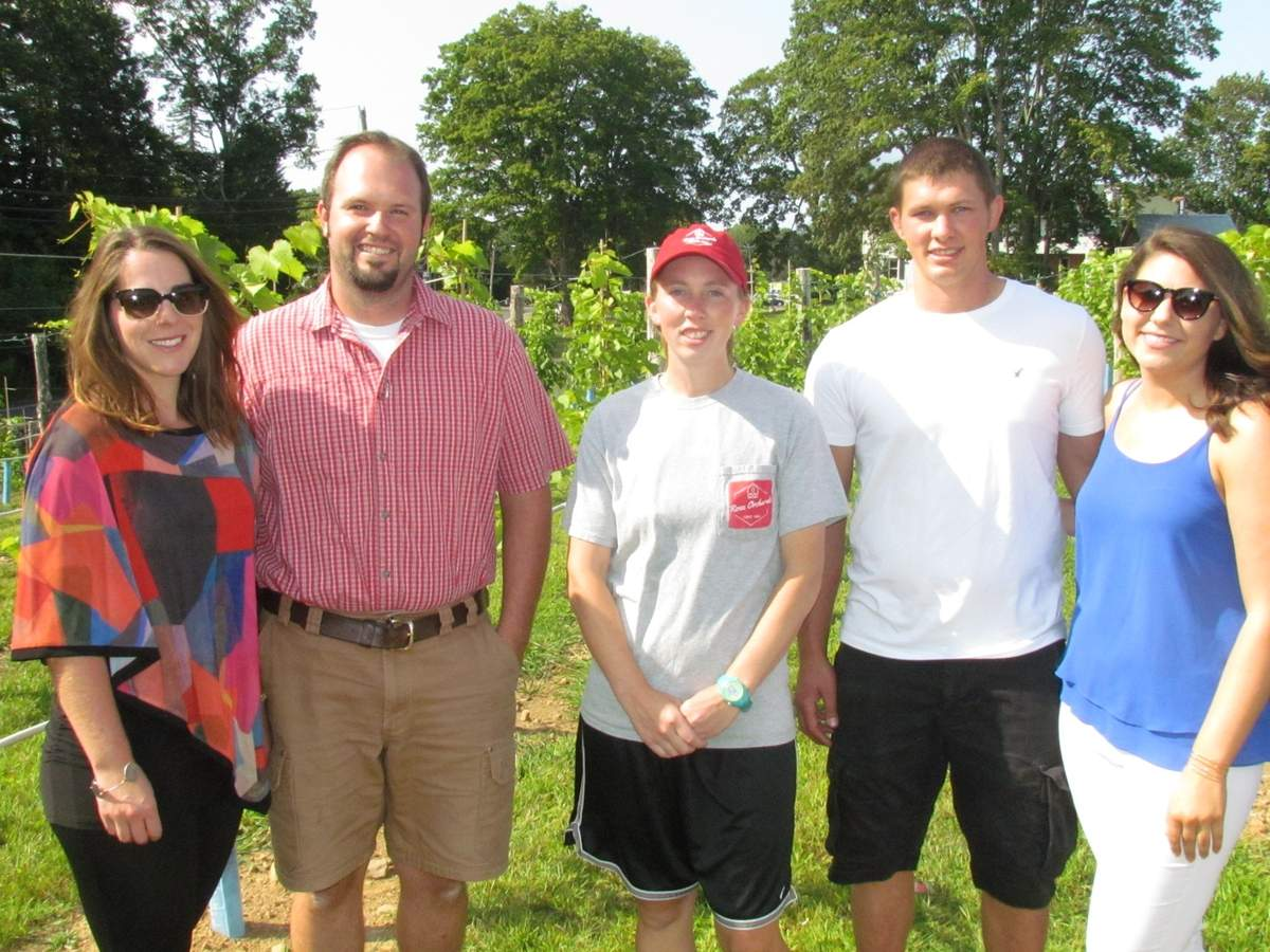 Joining vinter Jon Rose (second from left) on the grounds of North Branford's new Rose Vineyards and Winery are members of the next generation at Rose family farm, in operation since 1644. From left are Ellen Rose, Jon Rose, Stephanie Rose, Tyler Rose, and Rachael Cassella (not available for photo: Abbie Rose Walston and Nate Rose). Photo by Pam Johnson/The Sound