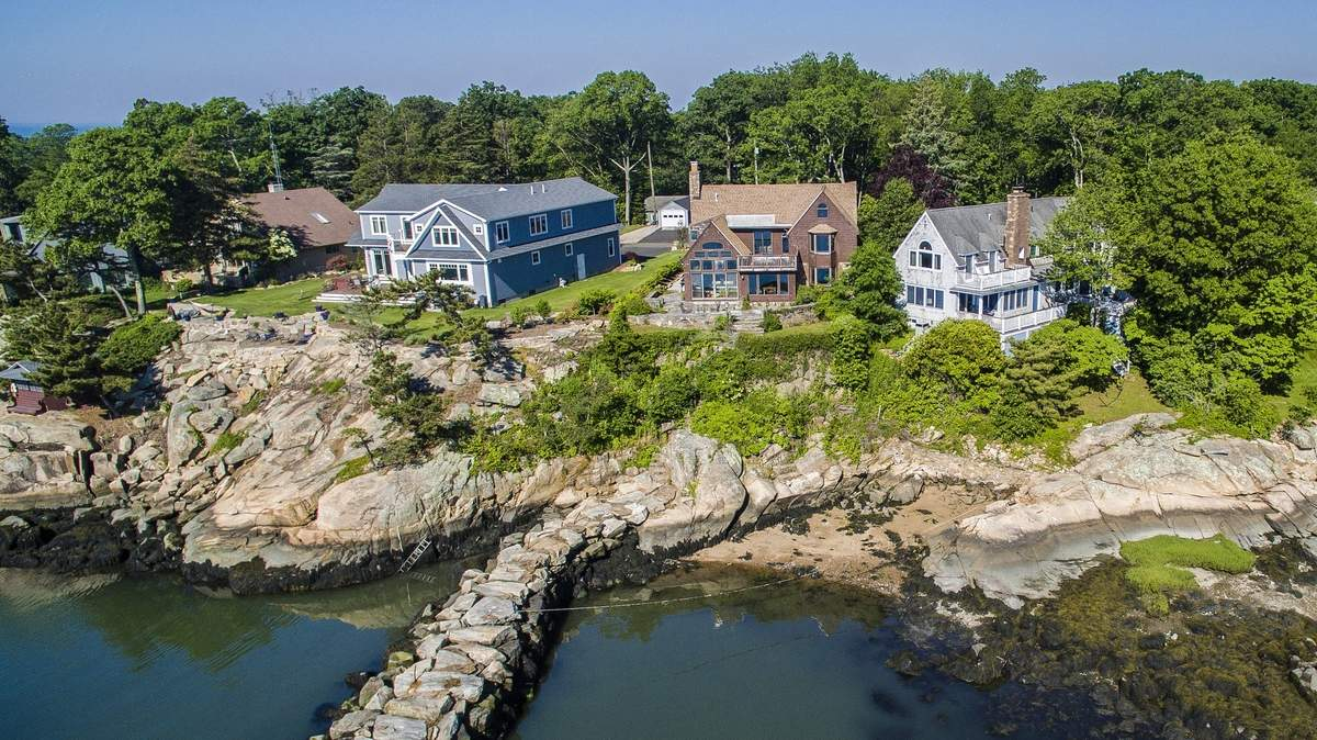 The house overlooks its own corner of Branford Harbor.