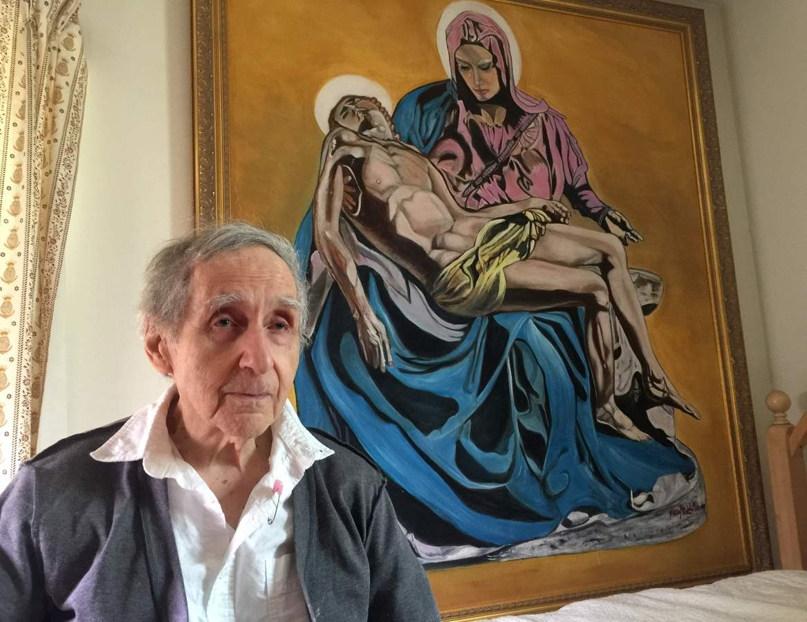 With six months' effort, Ralph Milione completed this painting of Michaelangelo's sculpture Pietà. He'll display it at the upcoming East Haven Fall Festival (Friday, Sept. 9 to Sunday, Sept. 11) with the hope that thosed touched by his art will also support another of his passions, helping those battling cancer. Photo by Matthew DaCorte/The Courier