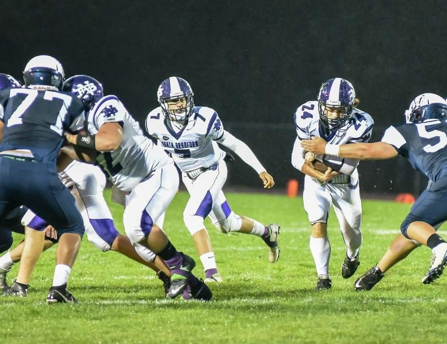 Junior Nick Mancini (carrying the ball) was a man on a mission when the North Branford football team began the fall season by beating Granby Memorial 27-21. Mancini rushed for 125 yards and scored the game-winning touchdown in the fourth quarter for the Thunderbirds. Pictured to the left of Mancini is Jeff Jablonski. Photo by Kelley Fryer/The Sound