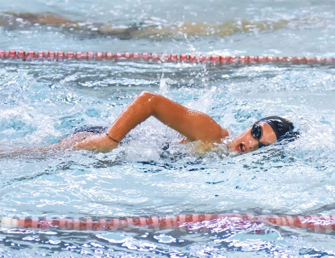 Laura Rosado and the East Haven-Cross girls' swimming and diving squad earned their first win as a co-op squad when they defeated Guilford by the final score of 86-75 on Sept. 13. Photo by Kelley Fryer/The Courier