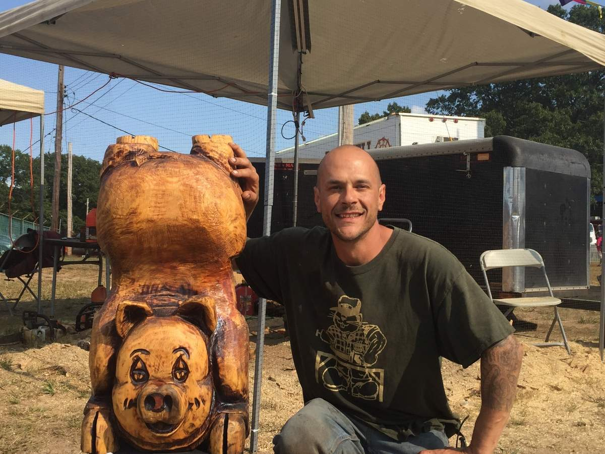 Artist Adam Mulholland was a hit at the North Haven Fair, with crowds watching him wield the chainsaw on his large wooden sculptures. Photo by Matthew DaCorte/The Courier