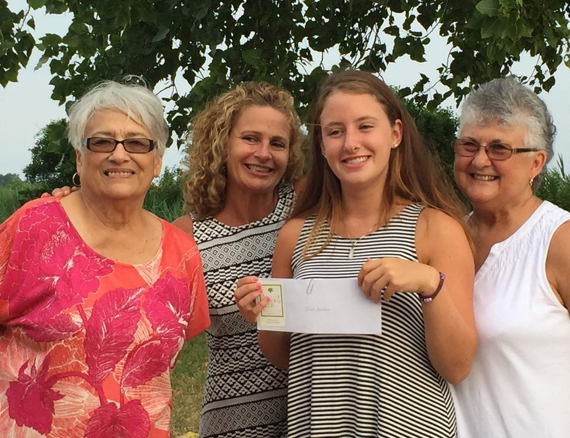 Arbor Garden Club of Clinton representatives Gail Webster (left) and Diane Gustafson (right) present the club's scholarship to Julia Anselmo (second from right, with her mom Suzy Anselmo). Photo courtesy of Doris Fallon