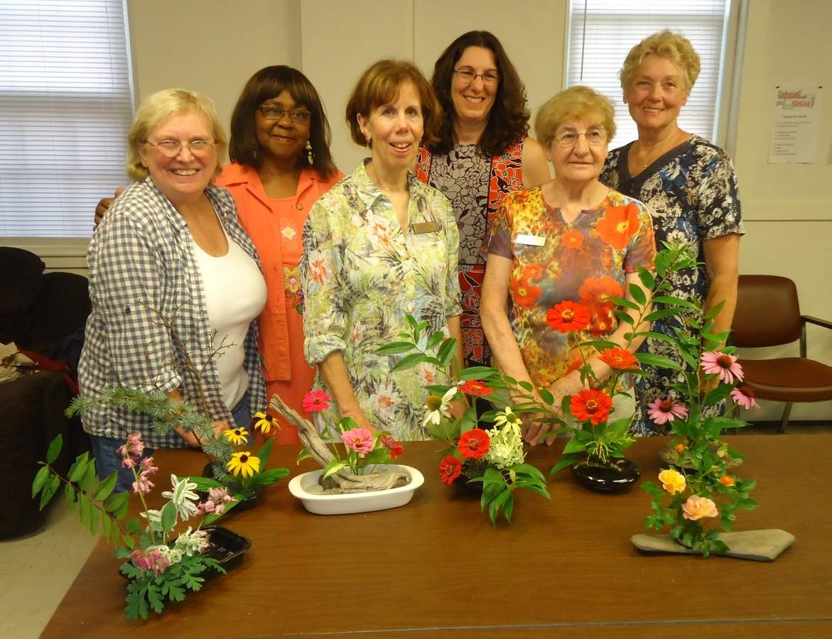 From left, (front) Sandy Ginter, Helen Nado, and Brenda Howlett and (back) Carmen Sealy, Ellen Young, and Jan Meinsen display their ikebana arrangements. Photo courtesy of Janice Meinsen