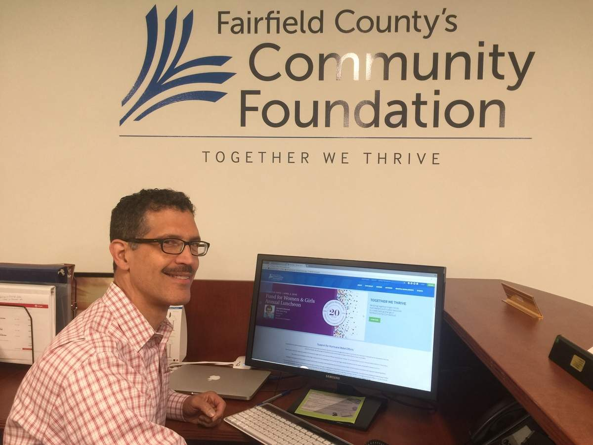 Joe Baker isn't putting his fiscal expertise to a good use—he's putting it to hundreds of good uses in his role as chief financial officer for Fairfield County's Community Fund. Photo by Matthew DaCorte/The Courier