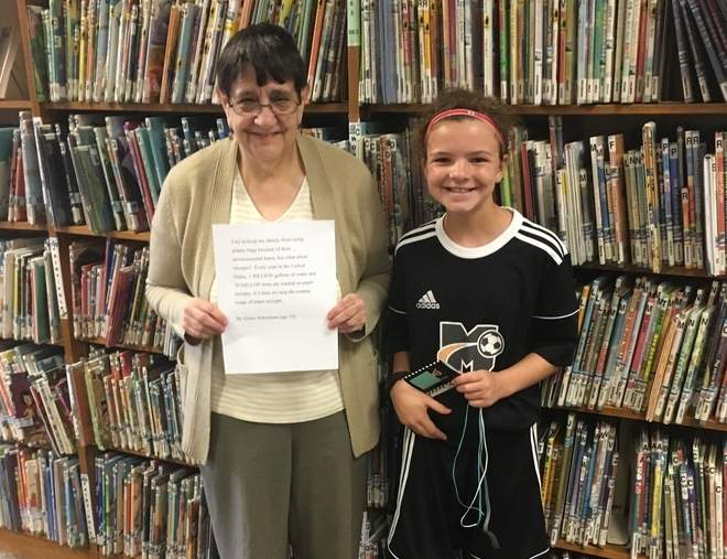 Scranton Library Children's Librarian Jane Ash displays the prize-winning essay written by Grace Ackerman, a 4th grader at Ryerson Elementary School.   Photo courtesy of Beth Ackerman