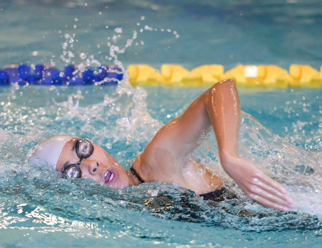 Senior captain Laura Rosado and the East Haven-Wilbur Cross girls' swimming squad picked up their second win of the year last week when the team defeated Sheehan 105-75. Photo by Kelley Fryer/The Courier