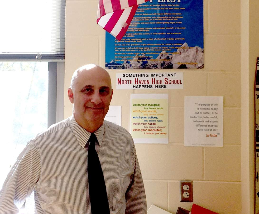 North Haven High School special education teacher Mike Proto is an advocate for veterans in and out of the school community. He's helping the First Priority club organize a veteran's benefit concert on Wednesday, Nov. 15 at the high school.  Photo by Matthew DaCorte/The Courier