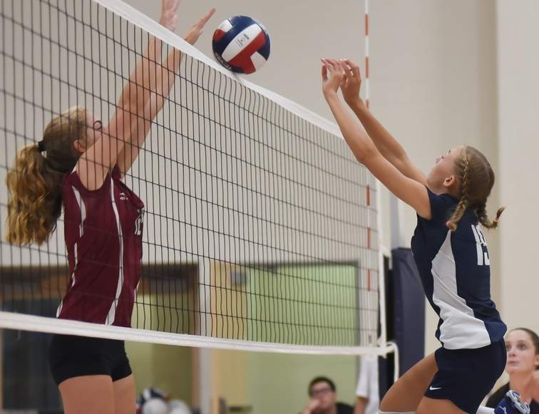 Junior Emily Hutchinson has been turning up the heat around the net for the Warriors' volleyball team. Hutchinson piled up the blocks last week to help Valley net three wins and finish the regular season at 17-3. Photo by Kelley Fryer/The Courier