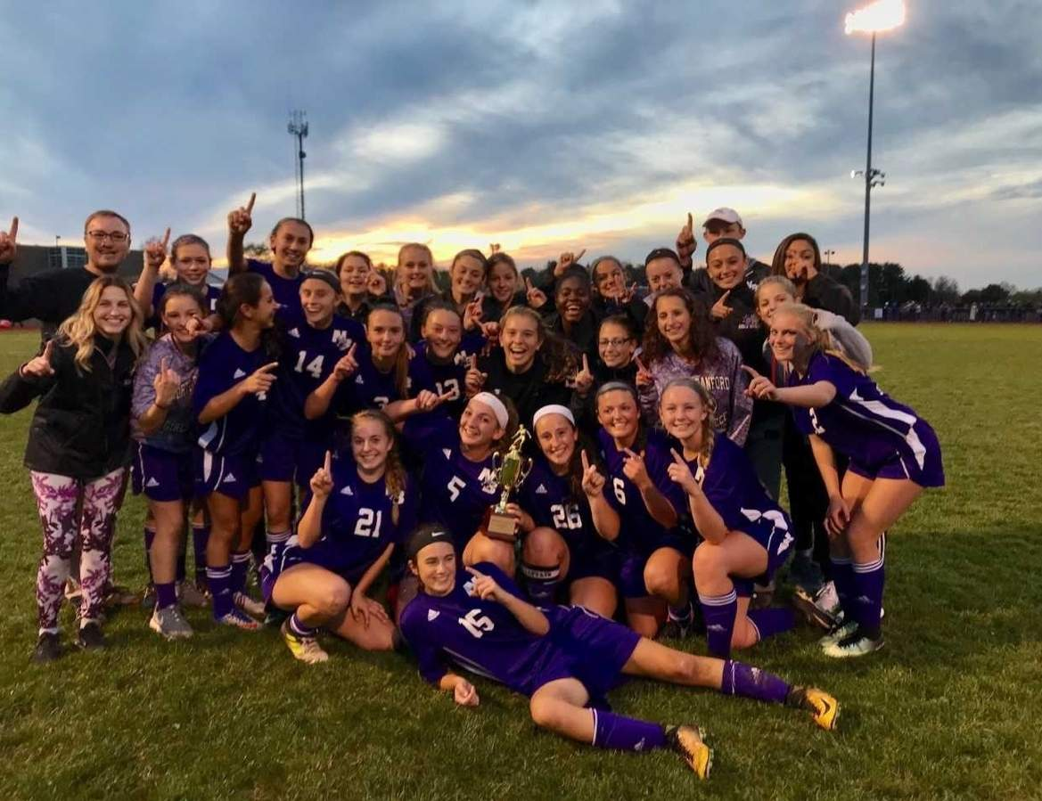The North Branford girls' soccer team defeated Old Lyme 2-1 in the Shoreline Conference Tournament championship game at Portland High School on Nov. 4 to claim its first league title with Head Coach Pat Kozloski.  Photo by Kelley Fryer/The Sound