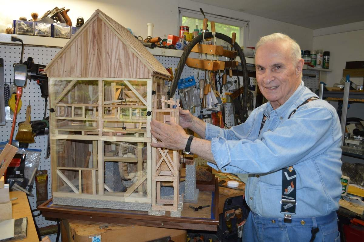 Nathan Jacobson with his intricately designed scale model of the Waterhouse Grist Mill, the subject of a free program in Chester on Nov. 12. Photo by Skip Hubbard
