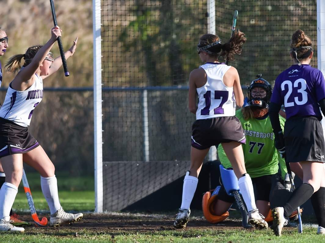 Angelina Ramada (left) celebrates after Ali Barrett (No. 17) scores one of her two goals in the North Branford field hockey team's 6-0 win over Westbrook in the Class S State Tournament quarterfinals. The T-Birds are facing Stonington in the semifinal round this week. Photo by Kelley Fryer/The Sound