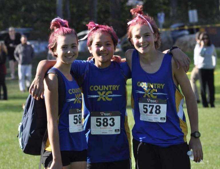 Pictured are Country School cross country runners Kayla Uzwiak, an 8th-grader from Killingworth; Ryan Wei, an 8th-grader from East Lyme; and Conor Selfor, and 8th-grade student from Old Saybrook. Photo courtesy of The Country School