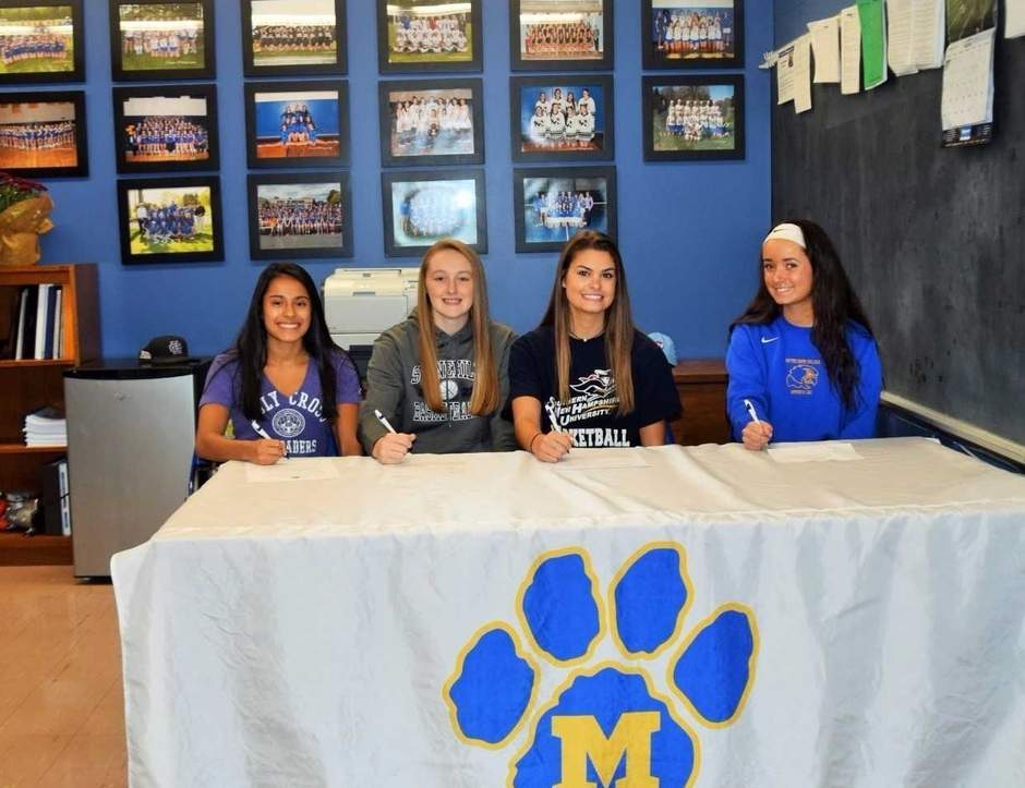 Four Mercy High School athletes recently signed their National Letters of Intent to play college sports. Pictured are Adriana Kandro from Portland, Isabella Santoro of Durham, Samantha Chapps from Old Saybrook, and Mariana Terenzio of Killingworth. Photo courtesy of Mercy High School