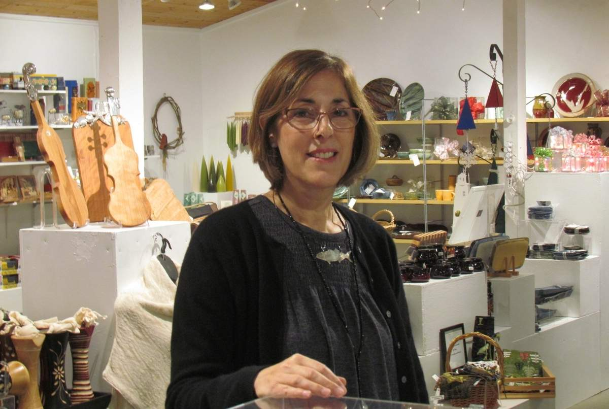For the past six months, Guilford resident and new Guilford Art Center (GAC) Shop Manager Elena Albergo has been working hard to bring the 40th annual Artistry to GAC, where holiday shoppers will find a gorgeous gallery of fine crafts at all price points, created by 200 artisans from around the country. All proceeds benefit the non-profit GAC.  Photo by Pam Johnson/Guilford Courier