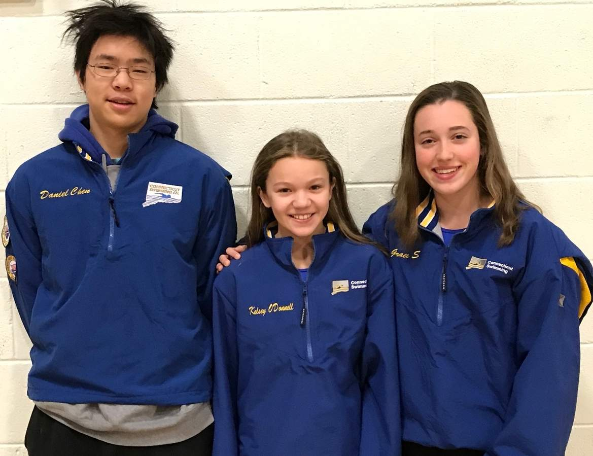 Daniel Chen of Madison, Kelsey O'Donnell of Ivoryton, and Grace Sweeney of Old Saybrook sport their Connecticut swimming jackets, which signify their placing in the top 16 fastest times in their respective events during the short- and long-coure seasons. Photo courtesy of Karen Sweeney