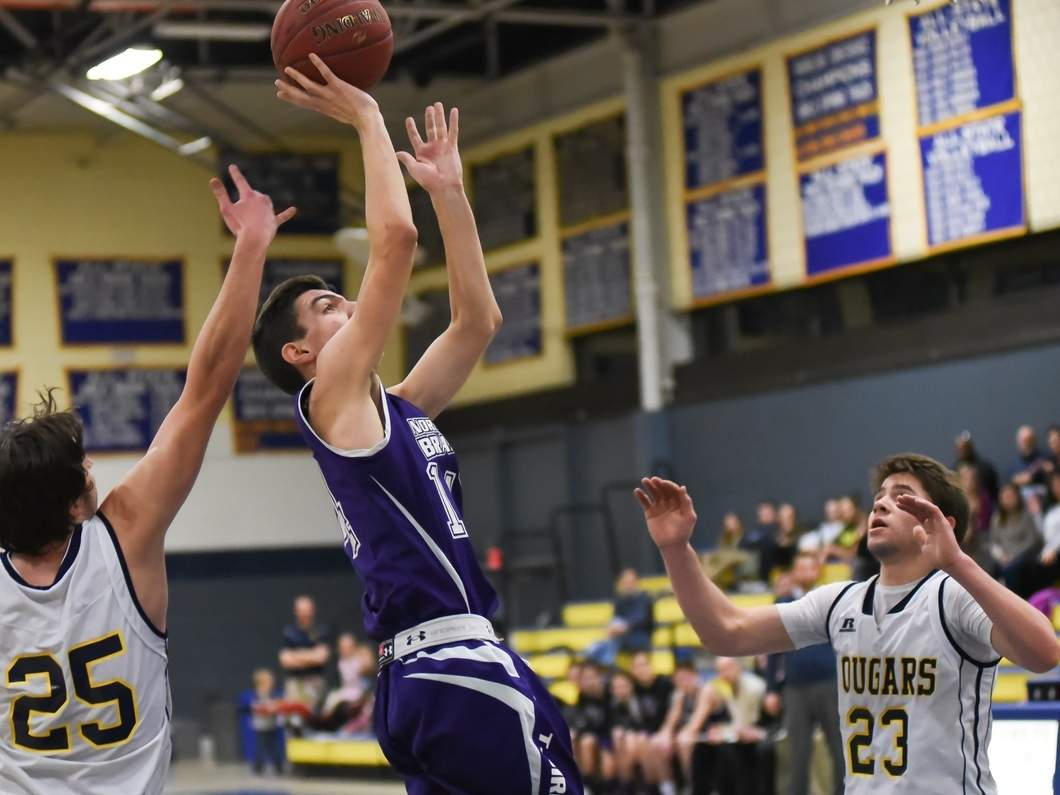 Jake Haeckel put on a shooting display by connecting on nine three-pointers when the North Branford boys' basketball team defeated Westbrook 69-32 on Dec. 21. Photo by Kelley Fryer/The Sound