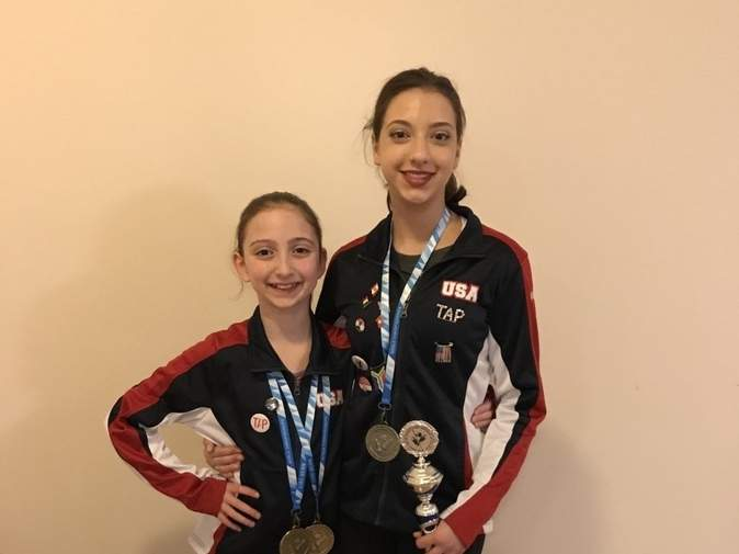 Juliana Montgomery (left) and Karissa Fryar, Guilford residents who dance at The Dancer's Studio in Northford, stand proudly with their awards following several successful performances at the World Tap Dance Championships in Germany last month. Photo courtesy of Sheri Bonanno