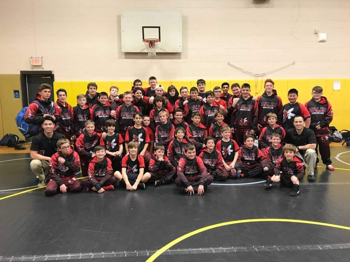 The Walsh Intermediate School wrestling team recorded win No. 100 in program history by posting a victory against Ledyard last month. Head Coach Tom Ermini's squad now gets ready for a packed schedule of matches throughout the rest of the season. Photo courtesy of Jenn McCulloch