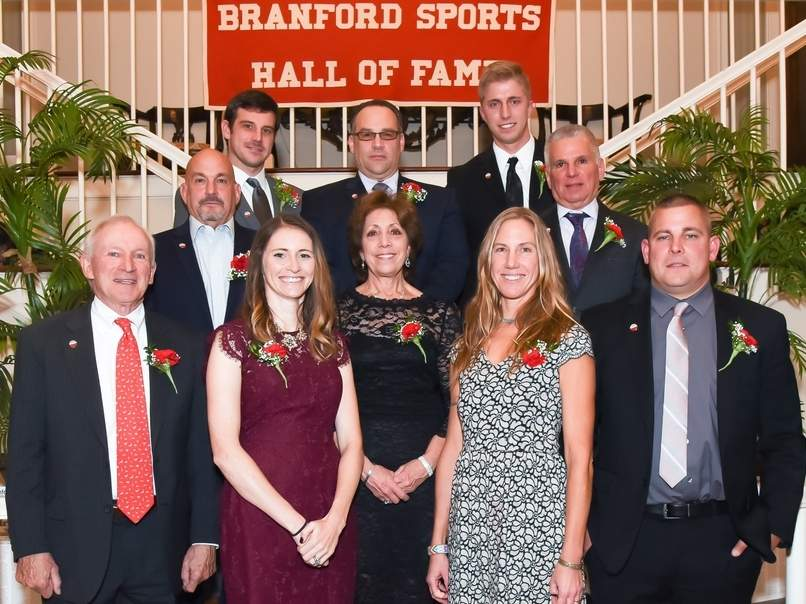"The Branford Sports Hall of Fame inducted nine individuals at its 30th annual dinner that took place at Woodwinds. Pictured are Ryan Thompson, Gary ""Jeep"" Ciarleglio, Nicholas Dummar (accepting for the late George T. Dummar, Jr.) Savas Synodi, Richard Tott, Kevin McDonough, Melissa McGow Klauder, Patricia Capone Dummar (accepting for Dummar, Jr., Sally Murphy-Noel, and Michael R. Tracy. Photo by Kelley Fryer/The Sound"