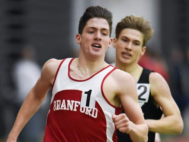 Junior Marzio Mastroianni took first place in the 1,000 and also ran on the victorious 1,600 sprint medley relay at the SCC Championship, helping the Branford boys' indoor track team finish seventh as a squad on Feb. 2. Photo by Kelley Fryer/The Sound