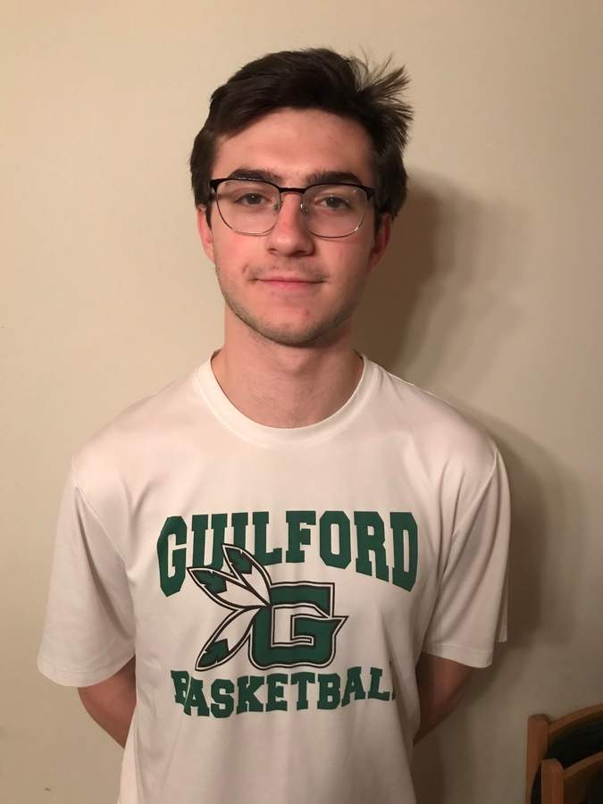 Senior James Hyman is contributing some valuable minutes off the bench for the Guilford boys' basketball team this winter, while also helping to further solidify the bonds among the athletes on the squad. Photo courtesy of James Hyman