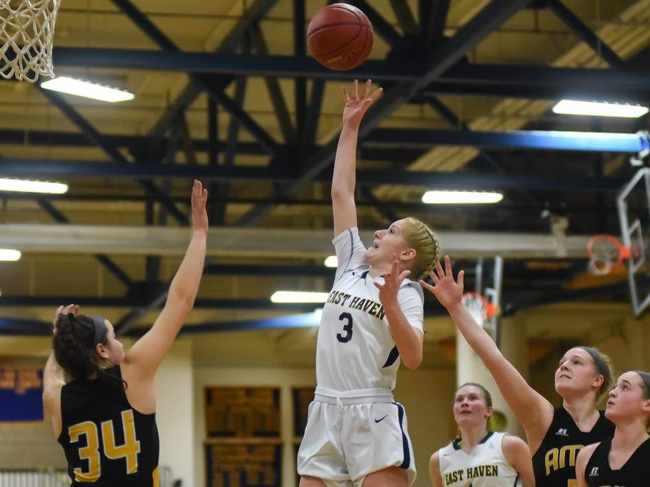 McKenzie Helms scored a game-high 31 points when the East Haven girls' basketball team outlasted Career by winning a 56-54 overtime decision in the SCC Tournament quarterfinal. Photo by Kelley Fryer/The Courier