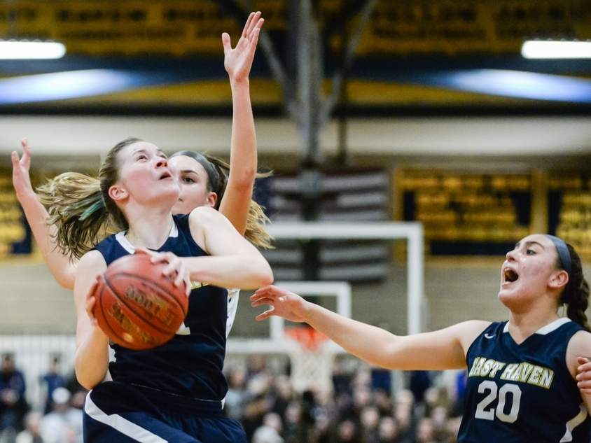 Kylie Schlottman (left) scored 22 points when the Yellowjackets' girls' basketball team faced Mercy in the SCC Tournament final at East Haven High School on Feb. 21. Mercy earned a 64-40 win against the Easties, who are playing in the Class M State Tournament that gets underway this week. Also pictured for East Haven is No. 20 Jessica Stettinger. Photo by Kelley Fryer/The Courier