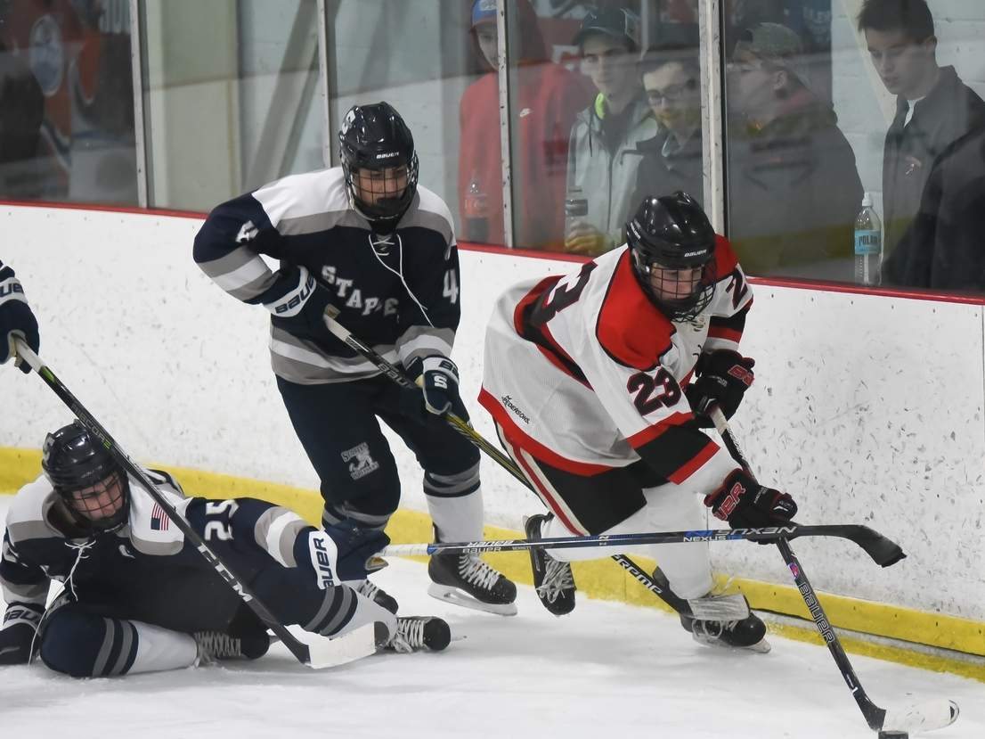 Max Bunton and the Branford boys' ice hockey team have won seven in a row and stand at 13-4-1 overall after notching a trio of victories in last week's action, including a win versus Hand in the President's Cup final. Photo by Kelley Fryer/The Sound