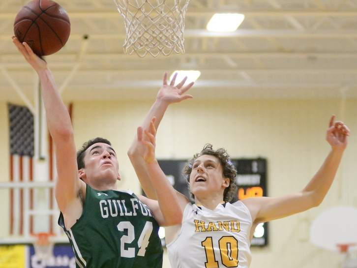 Sam Dombroski and the Guilford boys' basketball team will play in their first SCC Tournament semifinal since 2002 after defeating Career 49-47 in a quarterfinal contest on Feb. 24. Photo by Kelley Fryer/The Courier