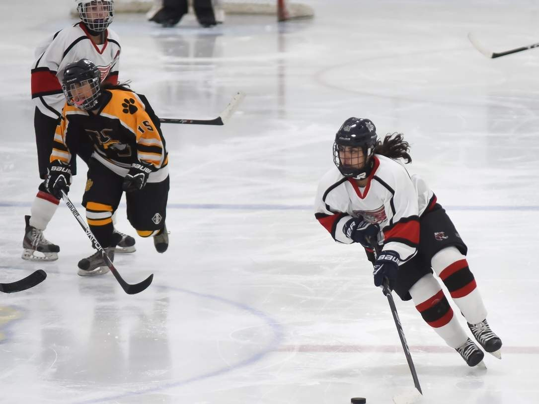 Julianna Constantinople netted a hat trick when the Branford-East Haven-North Branford girls' ice hockey squad upset Greenwich by a 4-1 score in the State Tournament quarterfinals on March 3. The Wings improved to 18-4 on the season and advanced to the state semis for the first time in program history by defeating the Cardinals. Photo by Kelley Fryer/The Courier