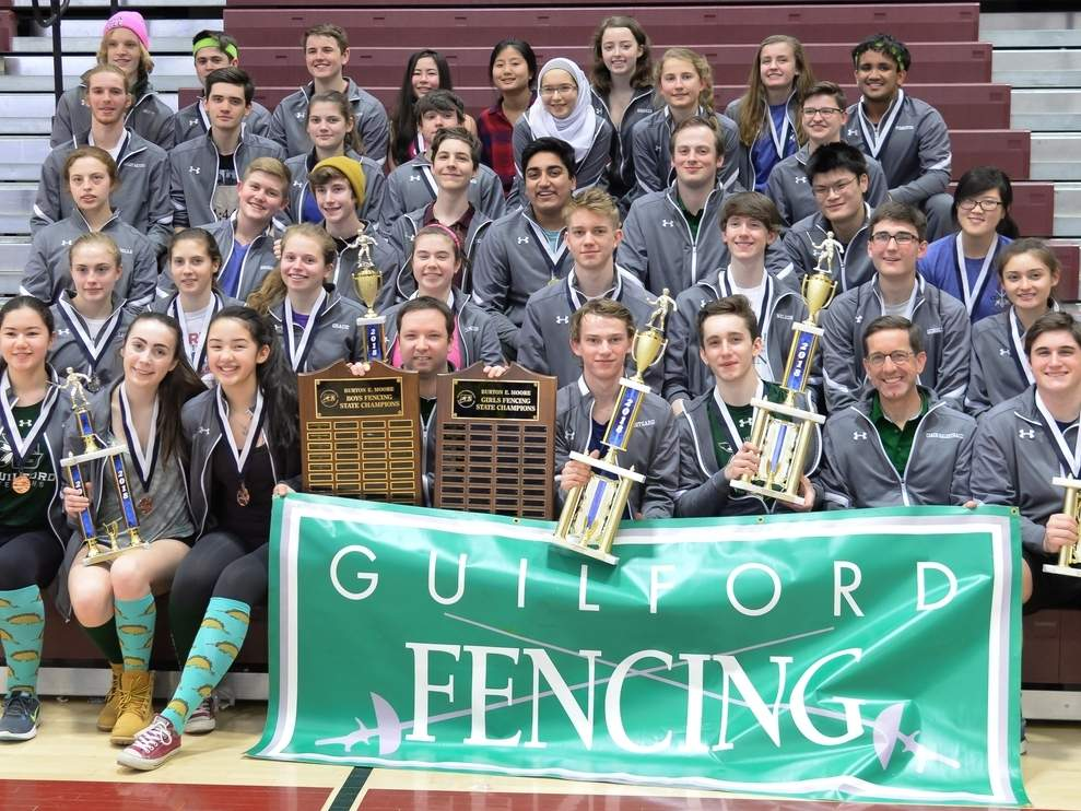 For the third straight year, both the Guilford boys' and girls' fencing squads celebrate with their respective overall state titles after putting together exceptional performances at the Team State Championships, which were held at East Lyme High School on March 10. Photo by Kelley Fryer/The Courier