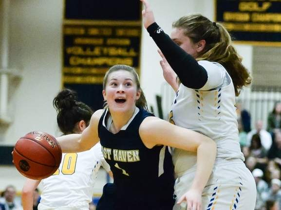 Senior captain Kylie Schlottman and the East Haven girls' basketball team are on their way to the Class M State Tournament championship game after storming back for a 56-52 win over Rocky Hill in the semis. Photo by Kelley Fryer/The Courier
