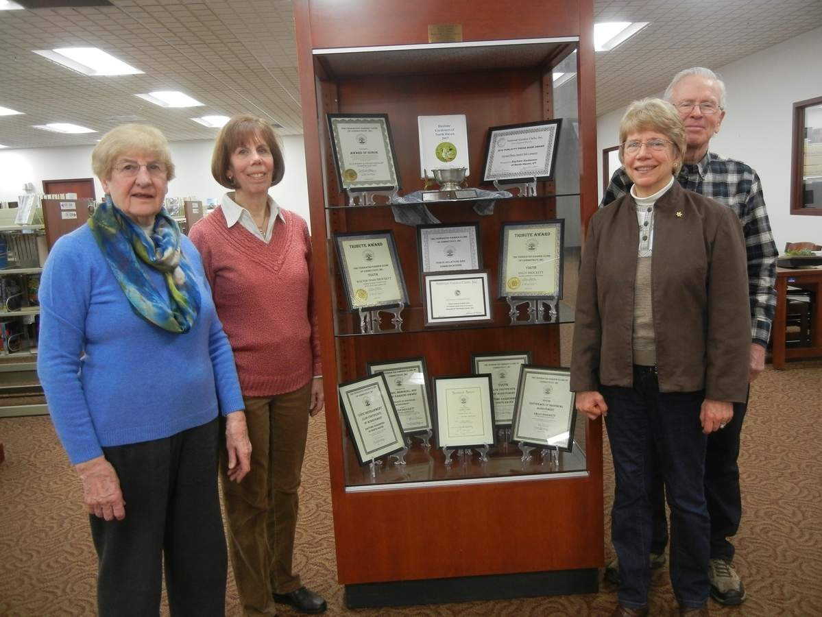 From left, Daytime Gardeners of North Haven Vice President Brenda Howlett, Secretary Helen Nado, President Sally Brockett, and Treasurer Walt Brockett display the clubs awards from 2017. Photo courtesy of Sally Brockett