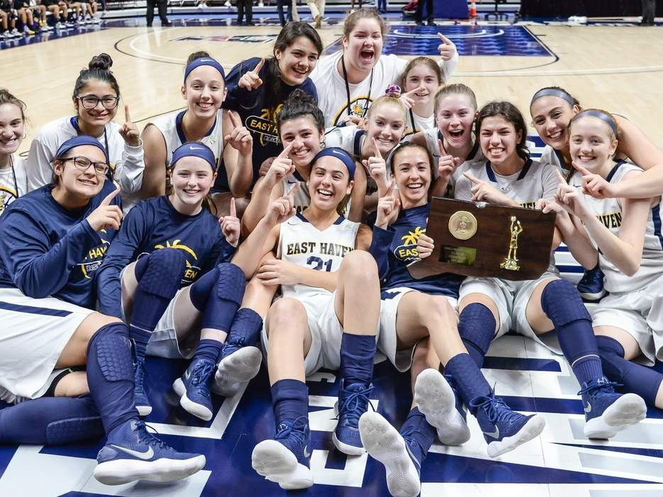The East Haven girls' basketball team won its first state championship by recording a dramatic 49-47 victory versus Career in the Class M State Tournament final on a basket by sophomore Isabella Ragaini as time expired.Photo by Kelley Fryer/The Courier