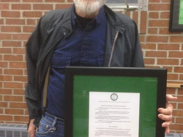 Bob Gregan receiving a plaque for 47 years of service on the NBLCT Board of Directors. Photo courtesy of Patty Meglio