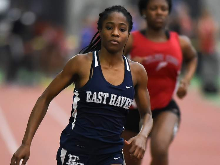 Kisha Francois had a fantastic freshman year for the East Haven girls' indoor track team by setting school records in the 55 and the long jump, while taking first place in each event at the SCC West Sectional Championship. Photo by Kelley Fryer/The Courier