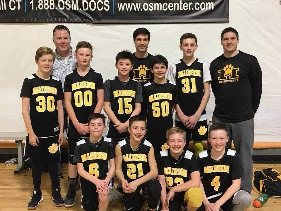 The Madison 6th-grade boys' basketball black team recently won the Fairfield County Basketball League playoff championship. Pictured from the squad are (back row) coaches Dan Shay, Dave Antonetti, and James Preskar; (middle row) players Nick Antonetti, Tai Nuzzi, Jack Shay, Jack Tompkins, and Kyle Hoffman; (front row) Aidan Doyle, Ben Kuja, Tyler Maynard, and Owen Preskar. Missing from the photo is Eli Ackerman. Photo courtesy of Lauren Preskar